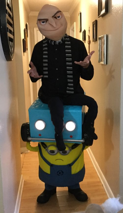Gru in Lucy Wilde's Car Carried by a Minion
